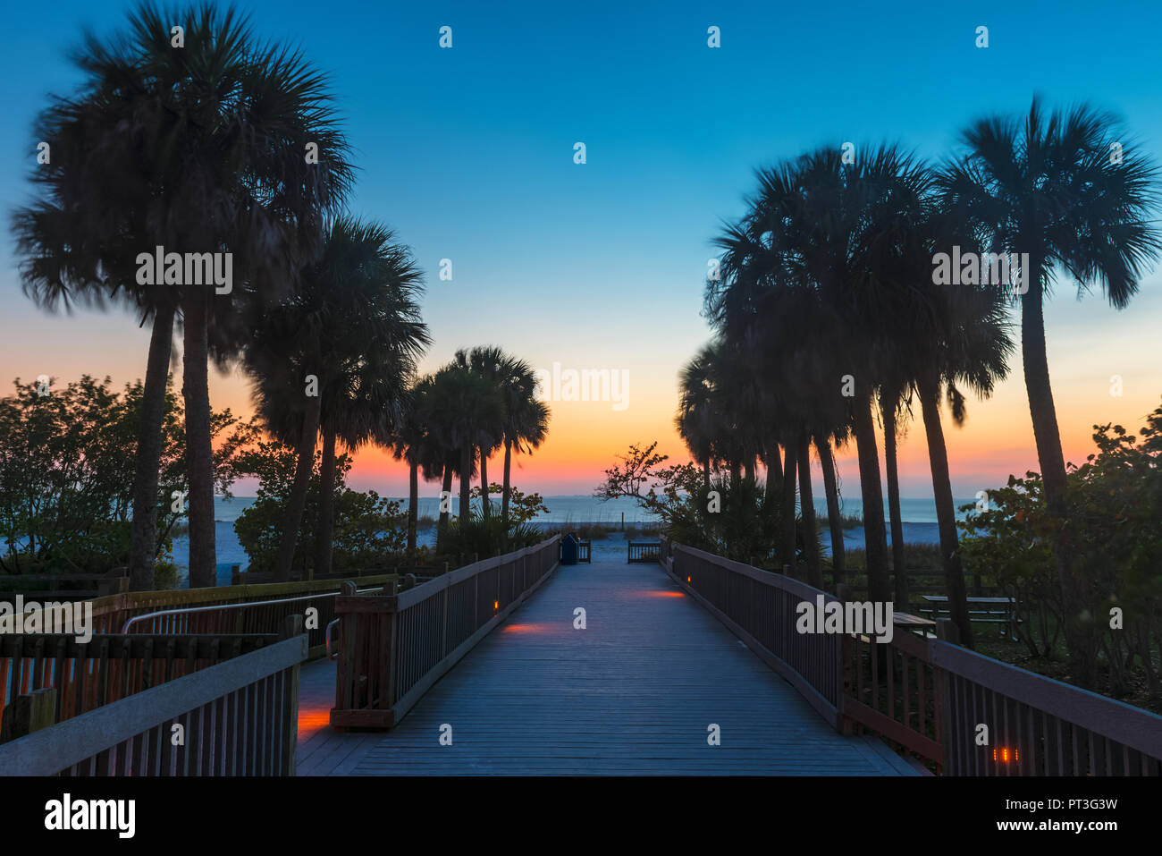 Wooden Boardwalk at Sunset in Fort Myers Beach Florida USA Stock Photo