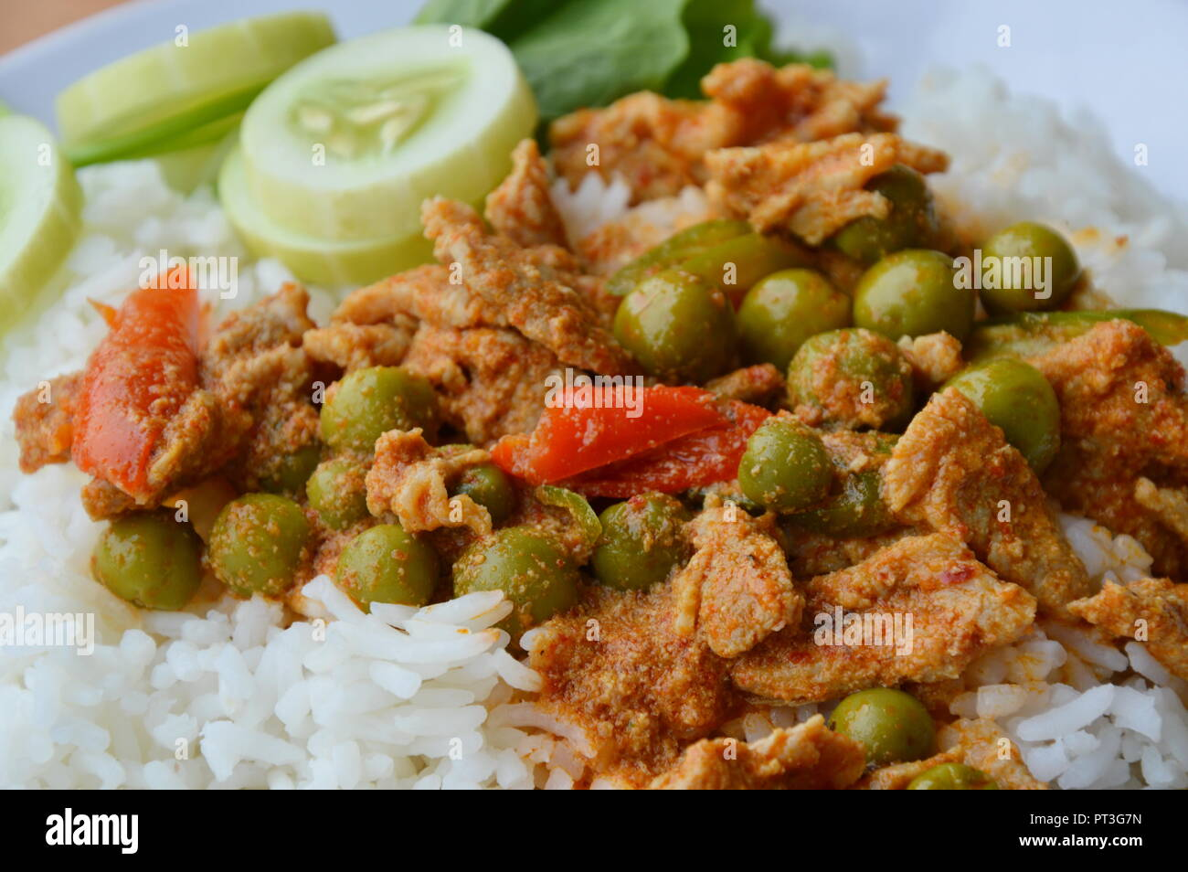 savory curry with pork on plain rice - Stock Image