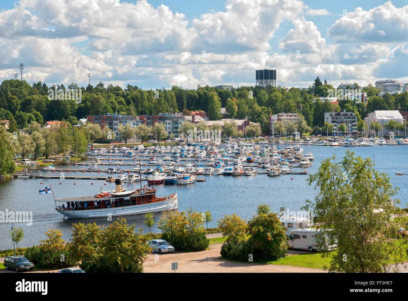 LAPPEENRANTA, FINLAND - AUGUST 8, 2016: People sail on a boat to Lappeenranta Harbor on Saima Lake. View from Linnoitus Fortress Stock Photo