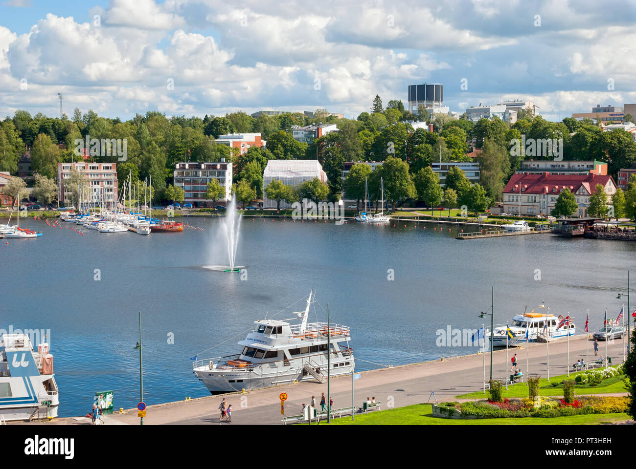LAPPEENRANTA, FINLAND - AUGUST 8, 2016: Summer landscape with fountain and boats in Lappeenranta Harbor on Saimaa Lake. Stock Photo