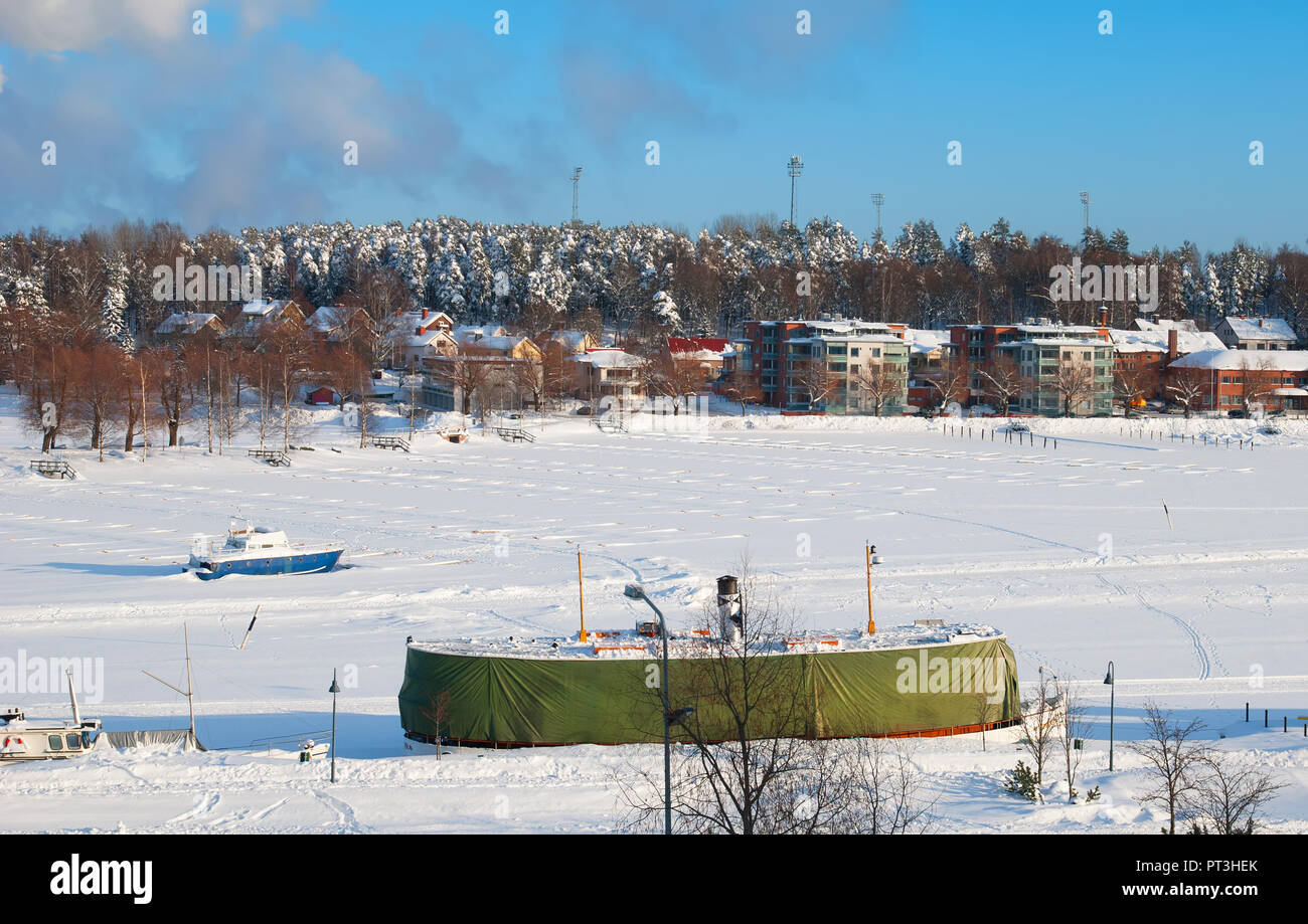 LAPPEENRANTA, FINLAND - FEBRUARY 18, 2010: Winter landscape with boats in harbor on Saimaa Lake. View from Linnoitus Fortress. Stock Photo