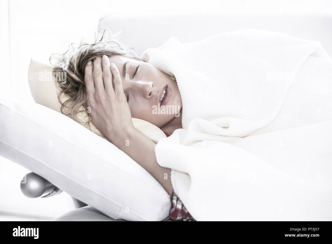 woman having a cold (model-released) - Stock Image