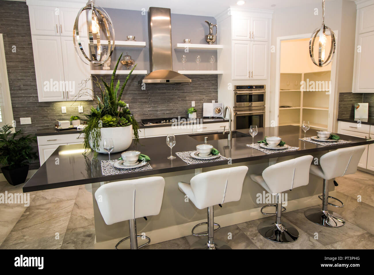 Modern Kitchen With Place Settings On Counter Bar Stock ...