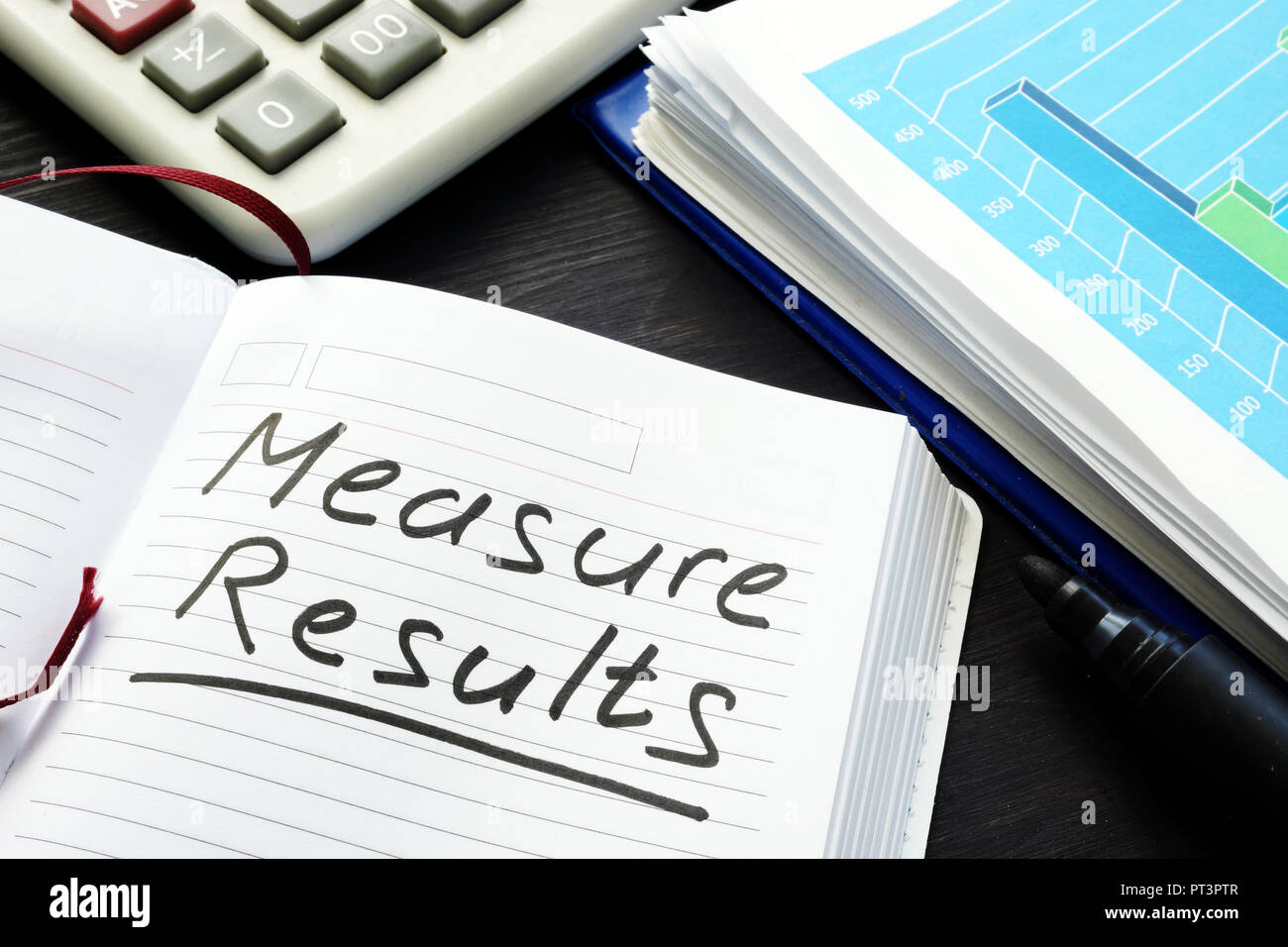Measure results written by hand in a note pad. - Stock Image