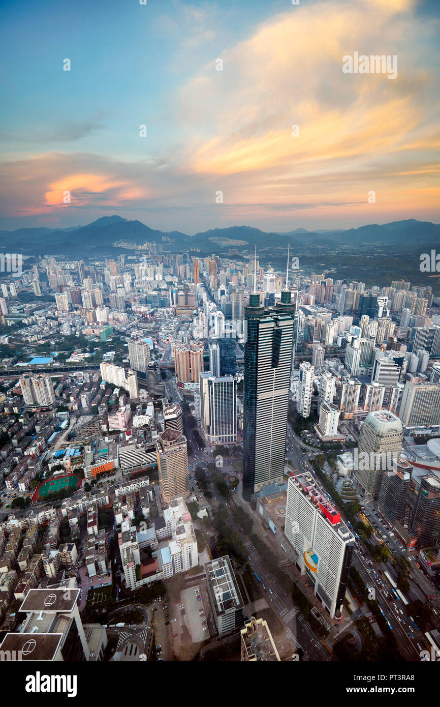 Aerial city view from the top of KK100 (Kingkey 100) skyscraper at sunset. Luohu District, Shenzhen, Guangdong Province, China. - Stock Image