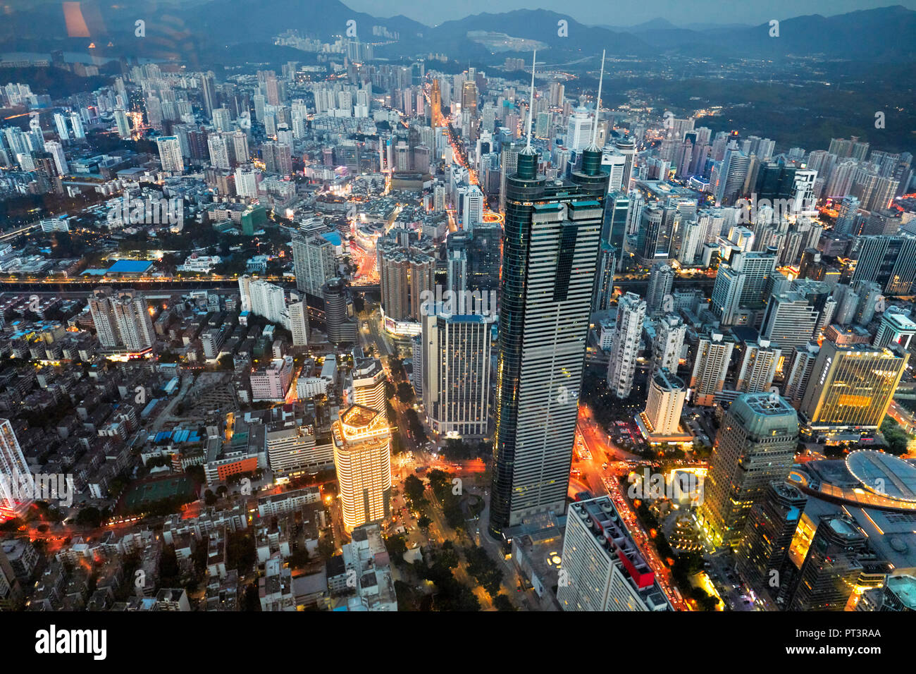 Aerial city view from the top of KK100 (Kingkey 100) skyscraper at dusk. Luohu District, Shenzhen city, Guangdong Province, China. - Stock Image