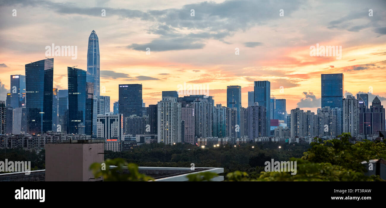 View of high-rise buildings in Futian District at sunset. Shenzhen, Guangdong Province, China. - Stock Image