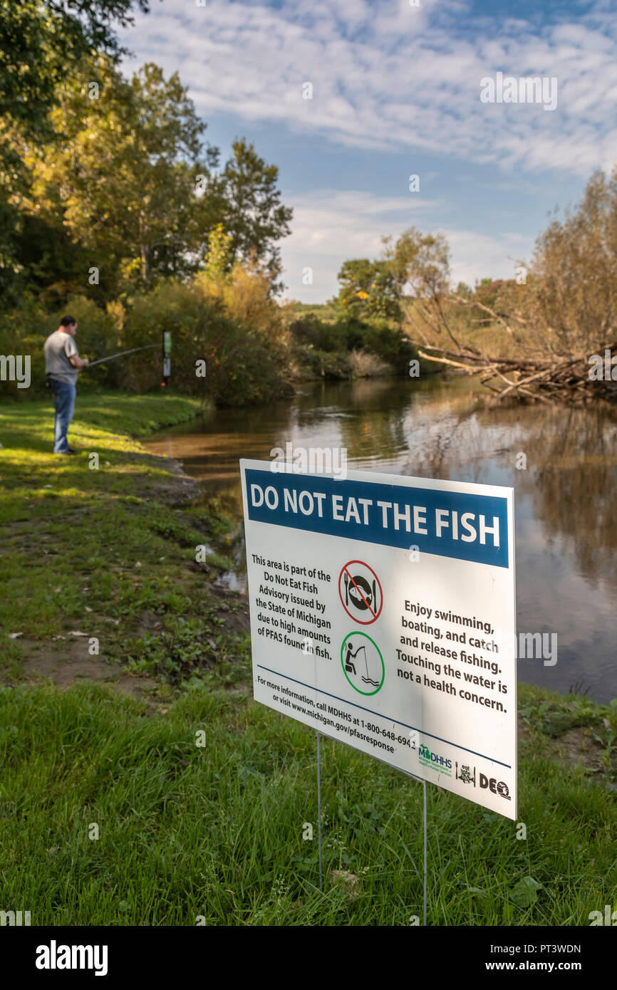 Brighton, Michigan - A sign at Island Lake State Recreation Area warns anglers not to eat fish from the Huron River. High levels of PFAS chemicals hav Stock Photo