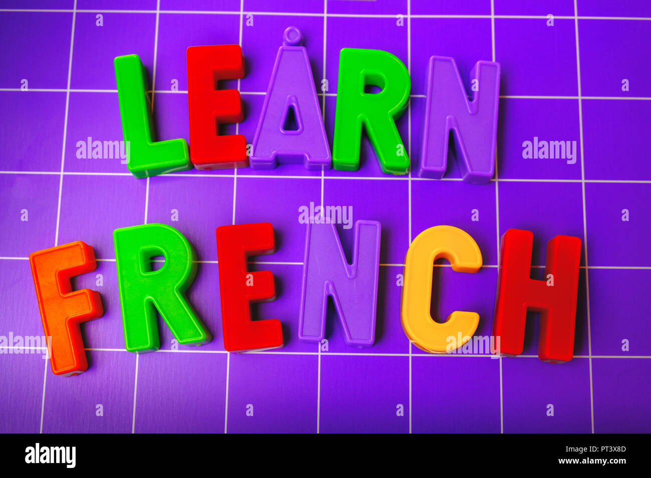learn french language alphabet on magnets letters - Stock Image