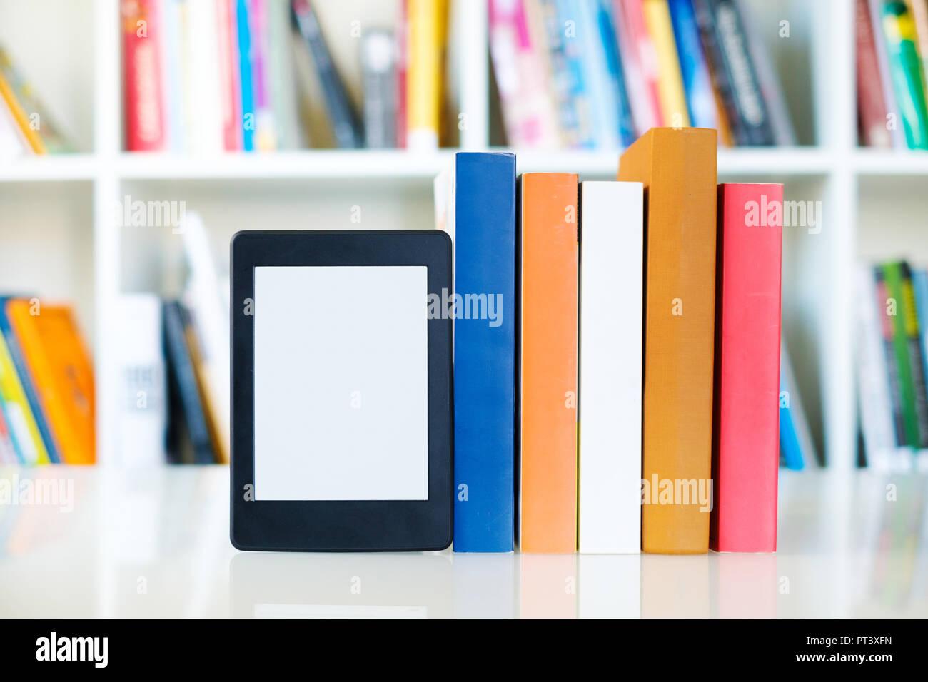 Ebook Reader And Paper Books On Bookshelf BackgroundCopy Space Digital Tablet Display