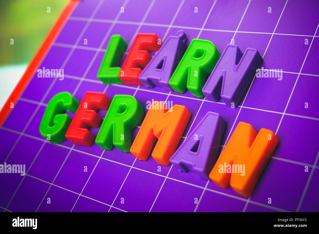 learn german language alphabet on magnets letters - Stock Image