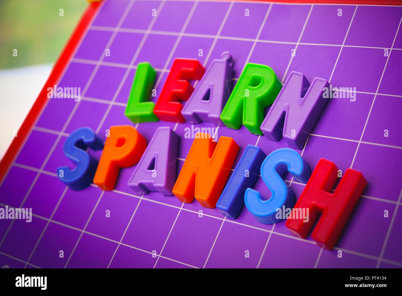 learn spanish language alphabet on magnets letters  - Stock Image