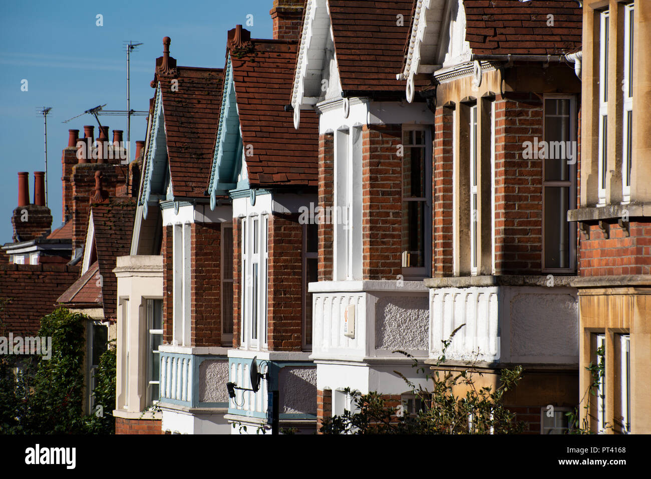 Terraced houses in East Oxford, UK - Stock Image