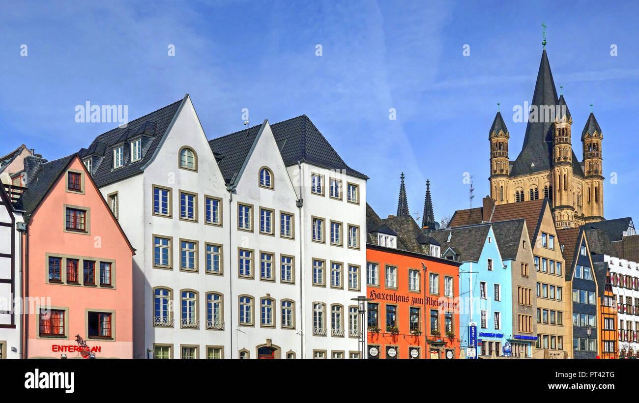 Houses at the Franken boatyard and Church Saint Martin, Cologne, North Rhine-Westphalia, Germany - Stock Image
