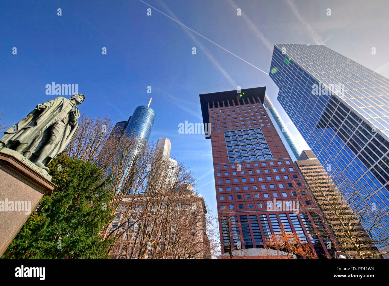 Schiller monument in the Taunus area and skyscrapers in the banking district, Frankfurt am Main, Hesse, Germany - Stock Image