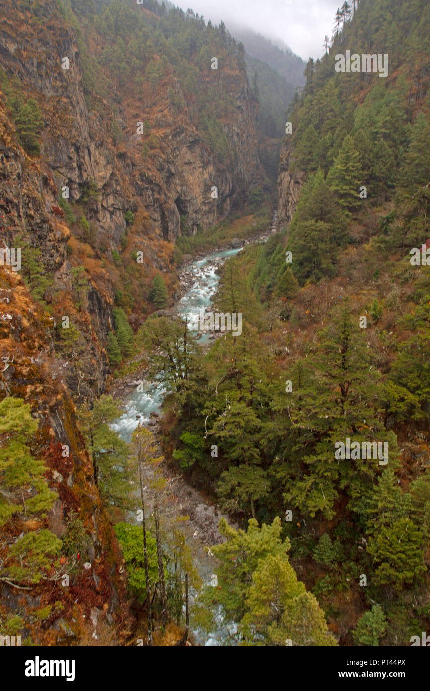 The Dudh Kosi, running through a gorge below Namche Bazaar - Stock Image