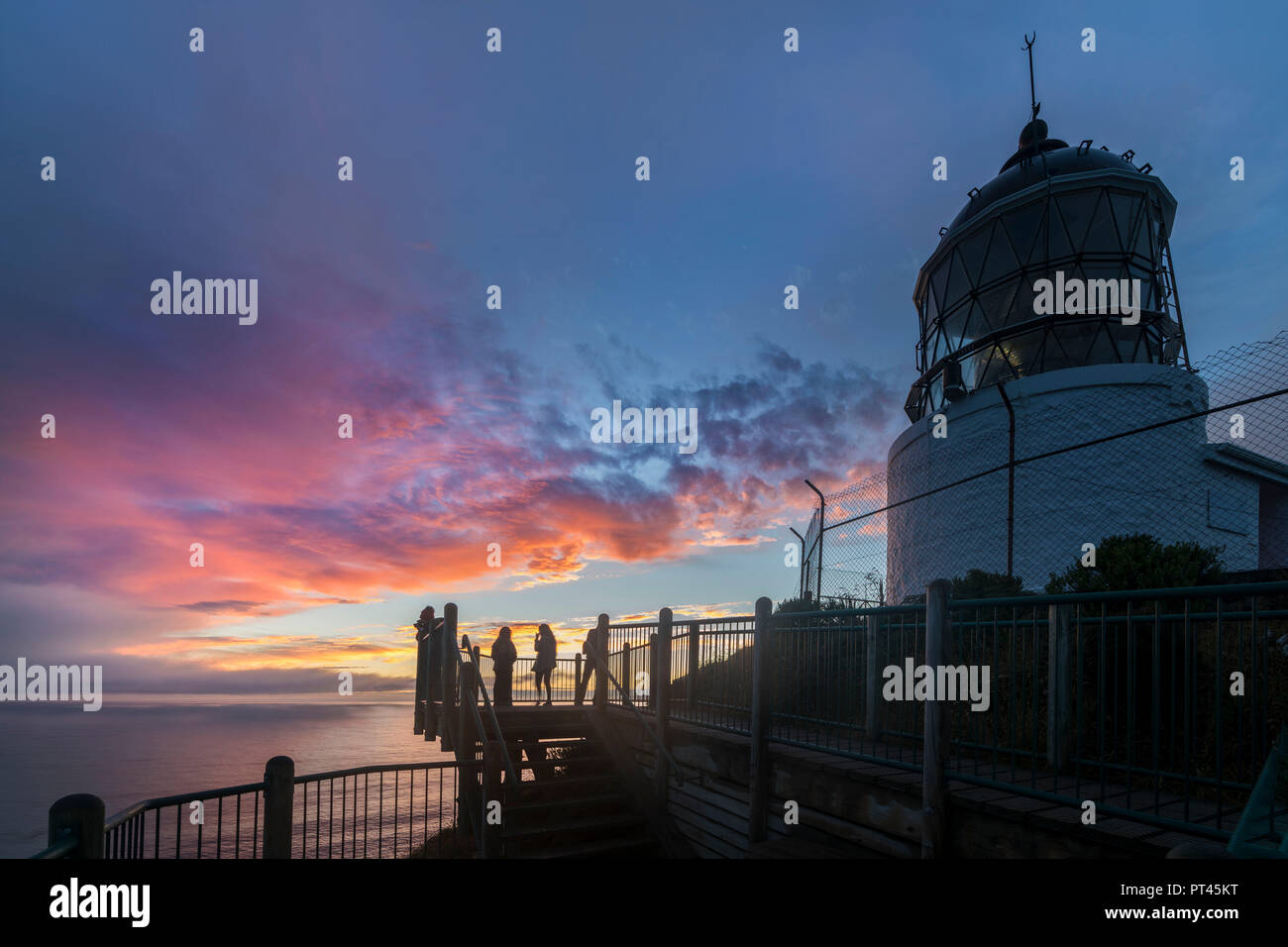 Sunset at Nugget Point lighthouse, Ahuriri Flat, Clutha district, Otago region, South Island, New Zealand, - Stock Image