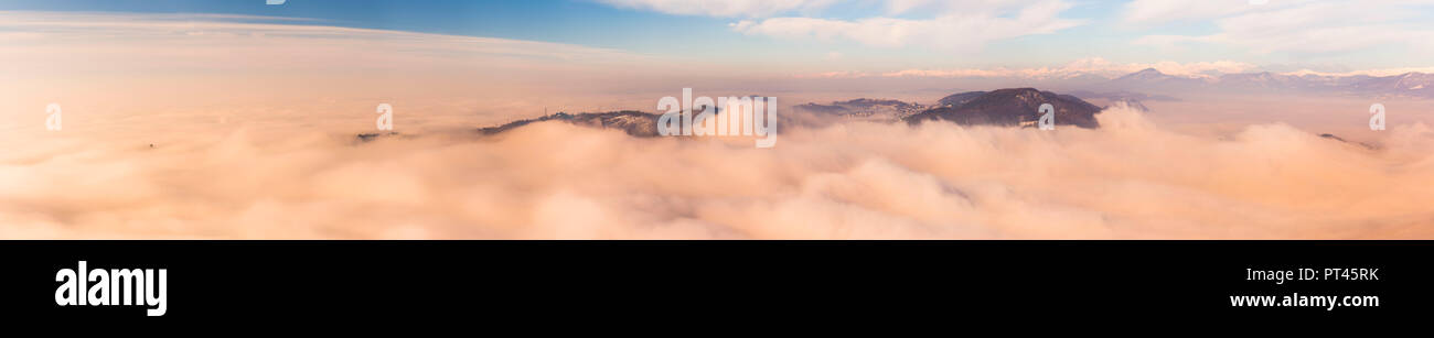 Panoramic of Spina Verde that rise up from a sea of clouds in a magic sunrise, Como province, Lombardy, Italy, Europe - Stock Image