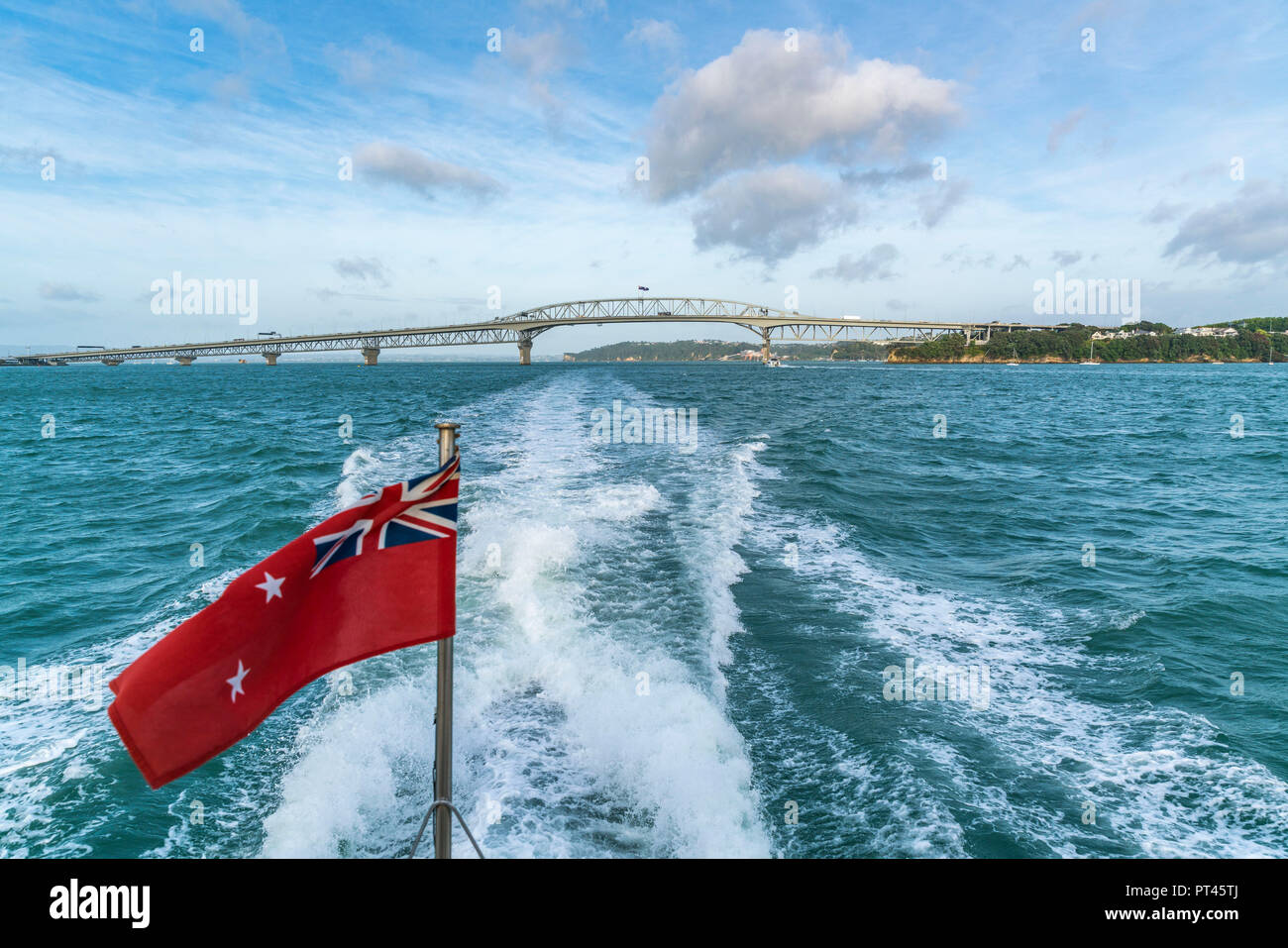 The New Zealand Red Ensign and Auckland Harbour Bridge in the background, Auckland City, Auckland region, North Island, New Zealand, - Stock Image