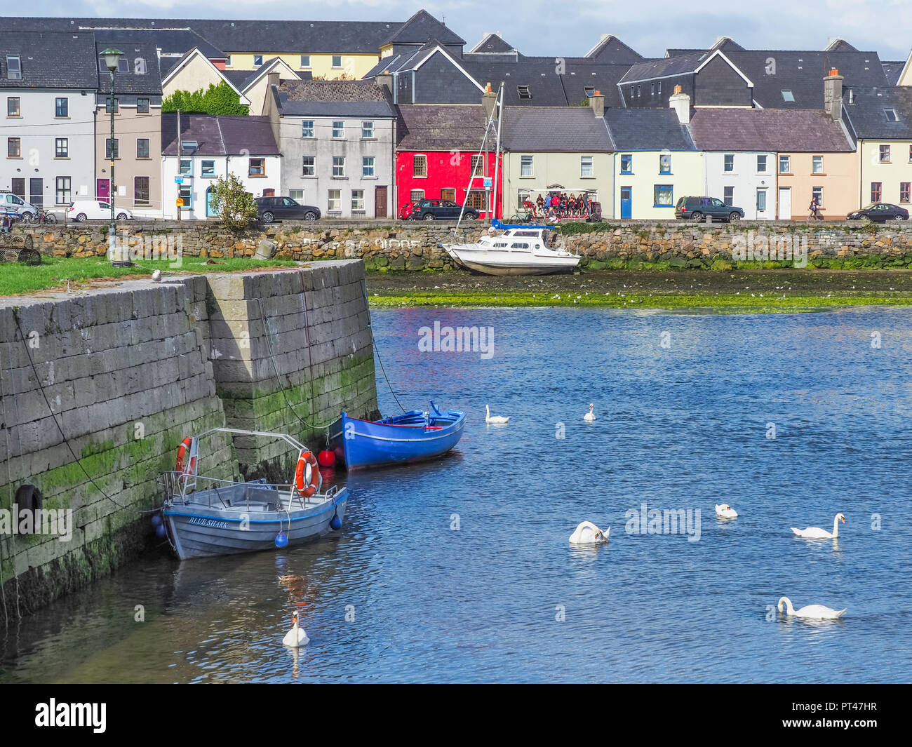 GALWAY, IRELAND - AUGUST 3, 2018: A view from the Claddagh Basin, across the River Corrib, towards the The Long Walk in Galway, Ireland. Stock Photo