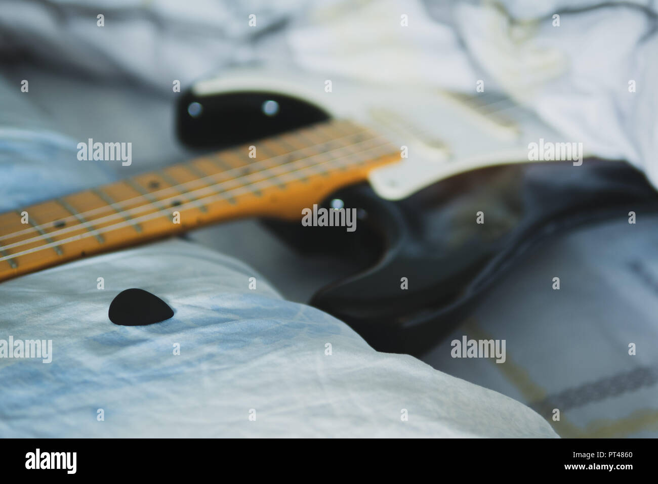Electric Guitar And Guitar Pick On Bed Stock Photo 221370408 Alamy