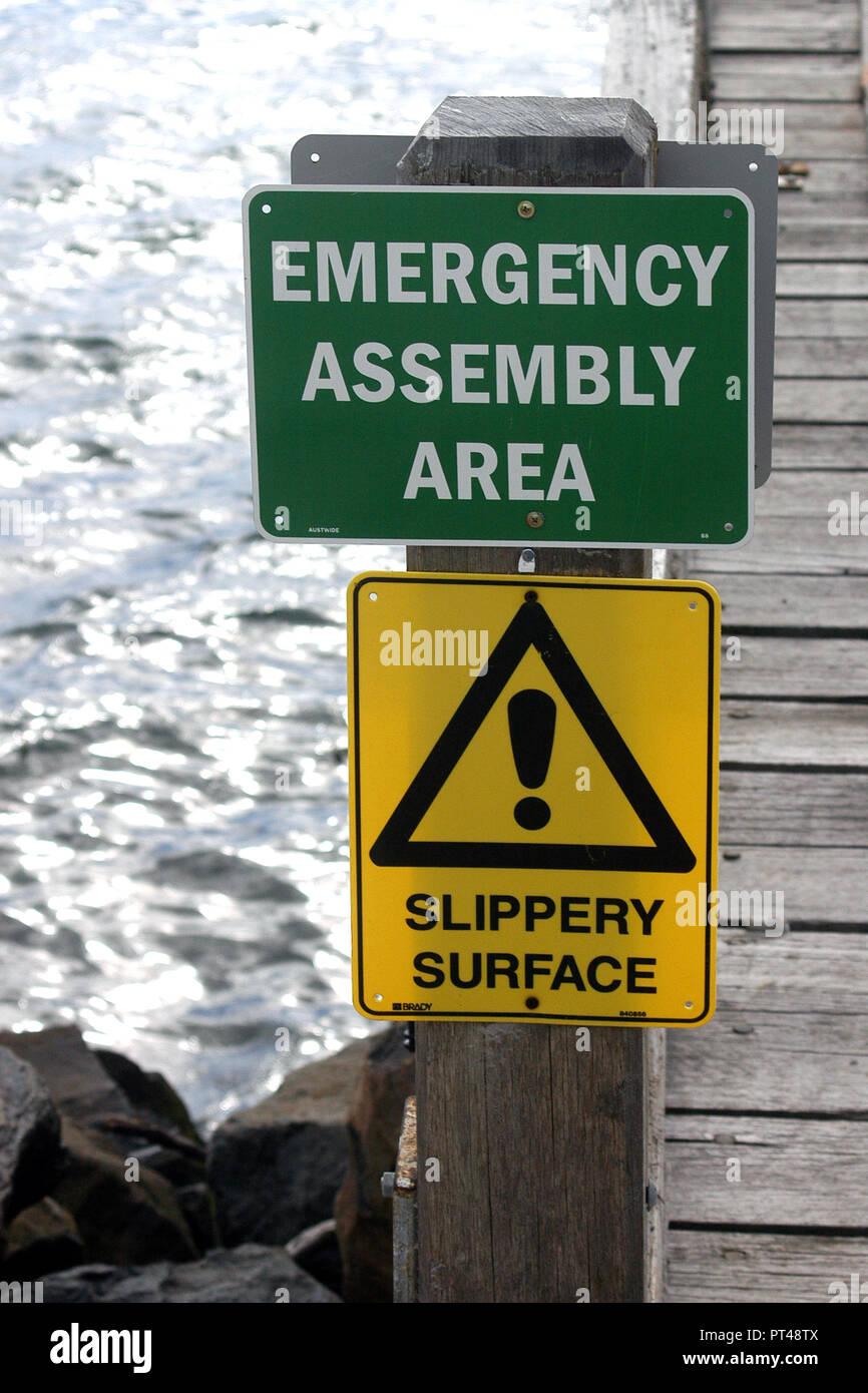 EMERGENCY ASSEMBLY EVACUATION AREA SIGN, COASTAL TASMANIA, AUSTRALIA - Stock Image