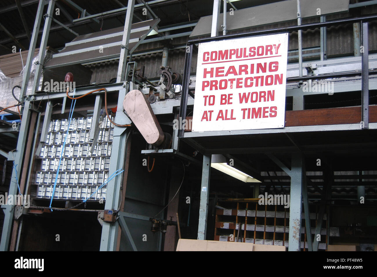 COMPULSORY HEARING PROTECTION SIGN IN A CANNERY FACTORY, TASMANIA. AUSTRALIA. - Stock Image