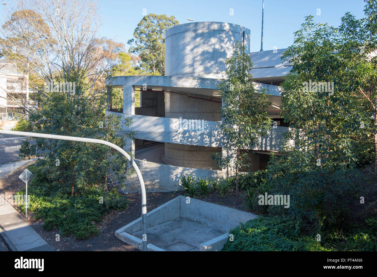 The circular end ramp joining different levels of a new multistory or multistorey carpark at Gordon railway station on Sydney Australia's north shore - Stock Image