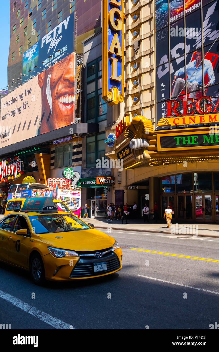 The busy streets of Times Square in Midtown Manhattan, New York, including the famous yellow cabs Stock Photo