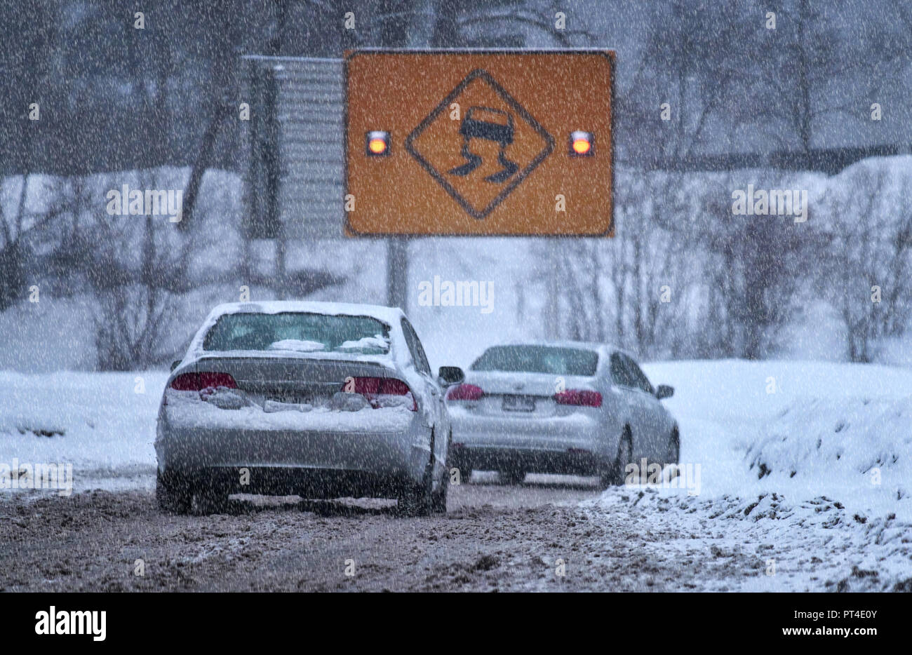 Montreal,Canada, 3 February 2018. Sign indicating slippery road condidtions during snowstorm.Credit:Mario Beauregard/Alamy Live News - Stock Image