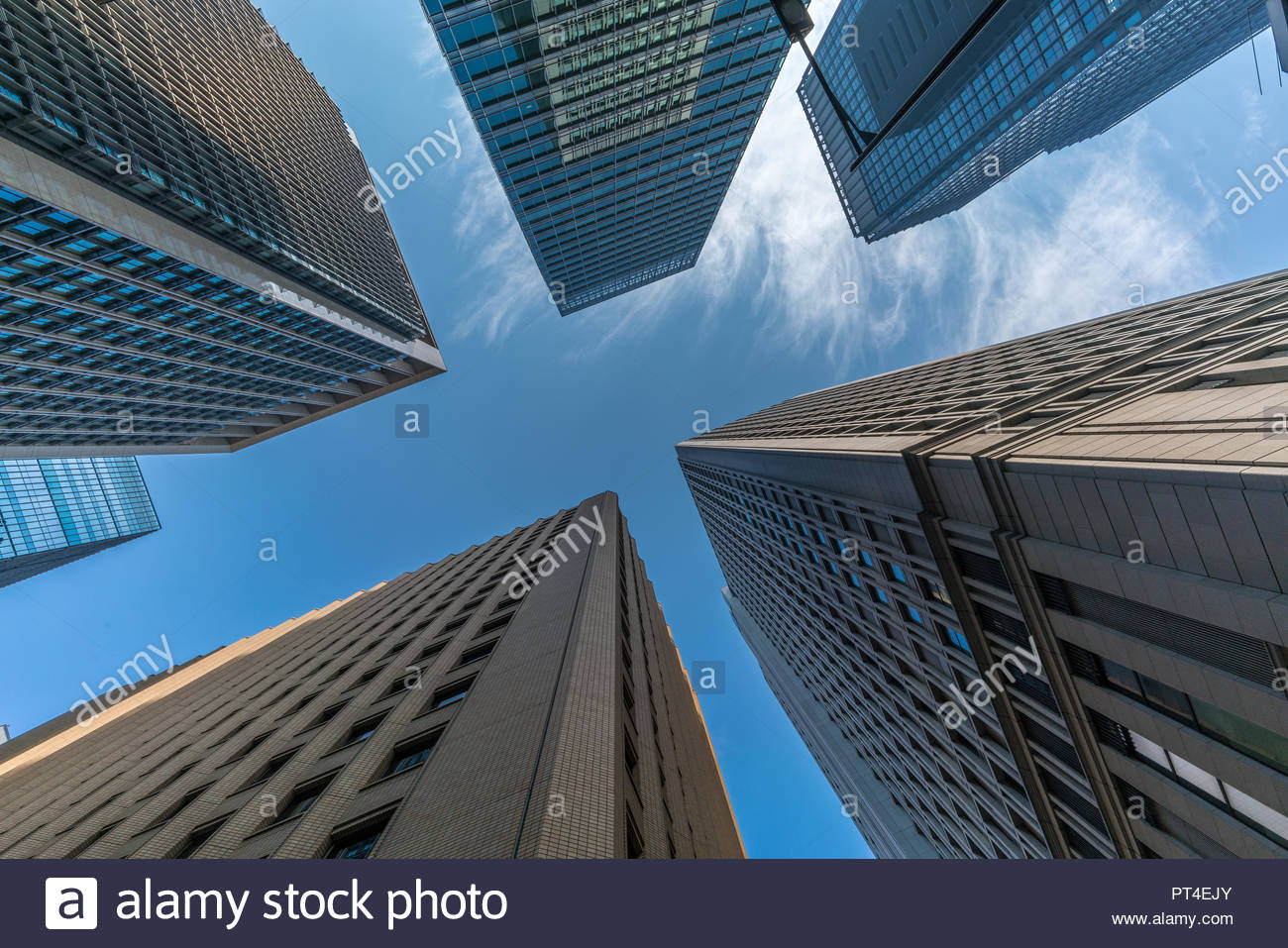 Tokyo, August 8, 2018. Groung level view of skyscraper buildings scenery. Marunouchi district located in Chiyoda Ward - Stock Image