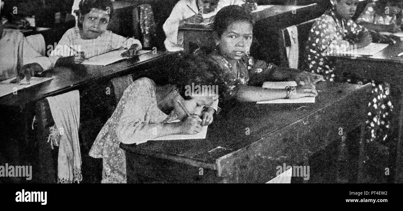 - EDUCATION - Batak Children being educated in a Sumatran school - from a circa 1940's publication - Stock Image