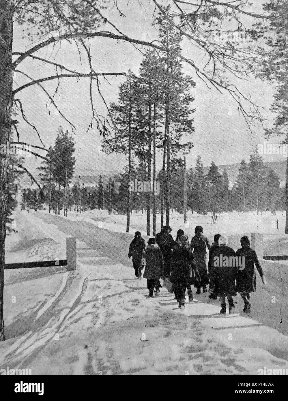 Children marching to school in Lapland from a hostel that caters for children from distant areas - From a c1940's publication - Stock Image