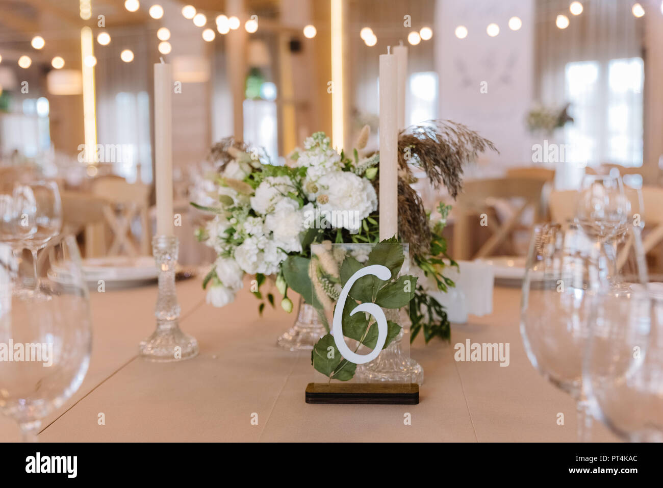 Decoration of a table for guests at a wedding in beautiful, gentle flowers - Stock Image