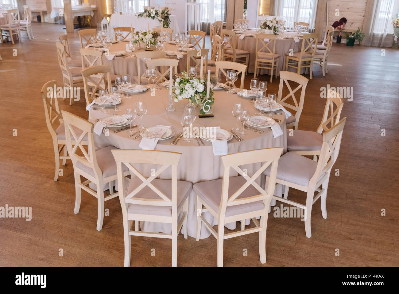 Festive lunch at restaurant. A wedding table for guests. Round banquet table - Stock Image