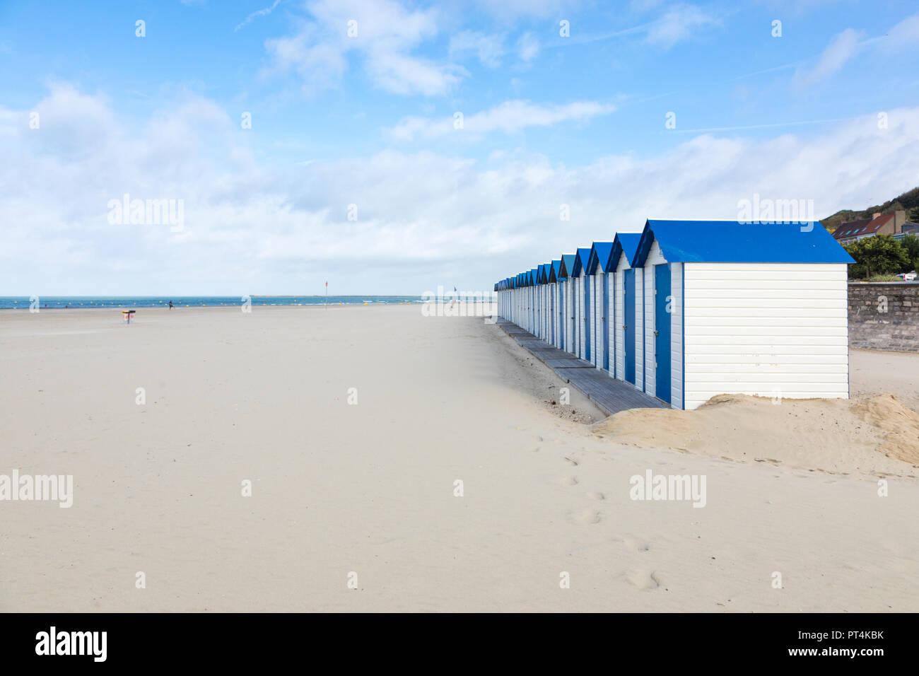 Row of blue and white beach huts at Boulogne-sur-Mer, Pas-de-Calais, France - Stock Image