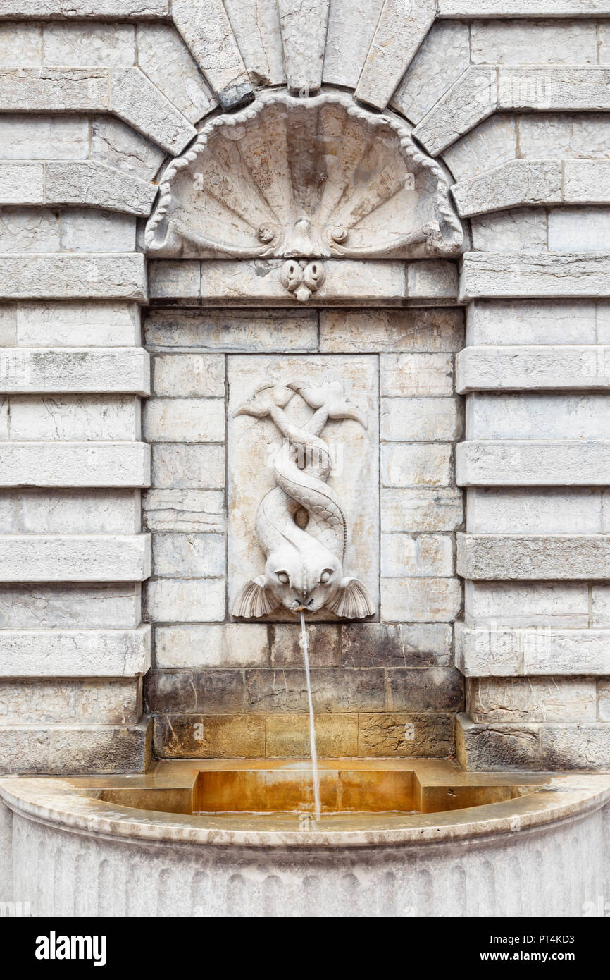 Ornate fountain with two-tailed fish at the fortified city of Boulogne-sur-Mer, Pas-de-Calais, France - Stock Image