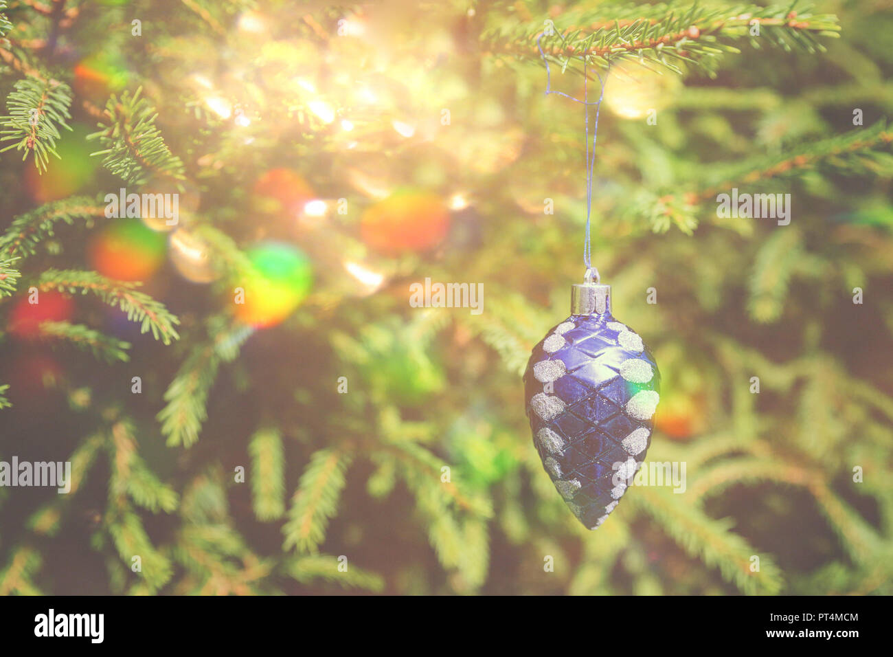 decorations on the christmas tree blue christmas ornaments on the xmas tree on glitter bokeh background with twinkle lights merry christmas card
