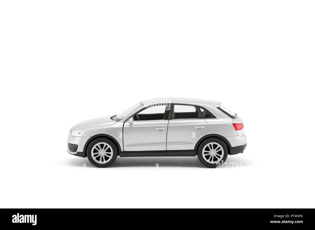 Silver toy car with clipping path on white background - Stock Image