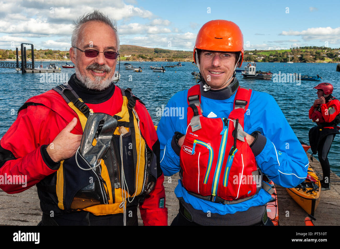 Schull, West Cork, Ireland. 6th Oct, 2018.  On a beautiful day in West Cork, Nick Depezay, Swords and Steven Darby, Cork prepare to go kayaking. Today's activities culminate this evening in a dinner dance at the Schull Harbour Hotel. Credit: Andy Gibson/Alamy Live News. - Stock Image