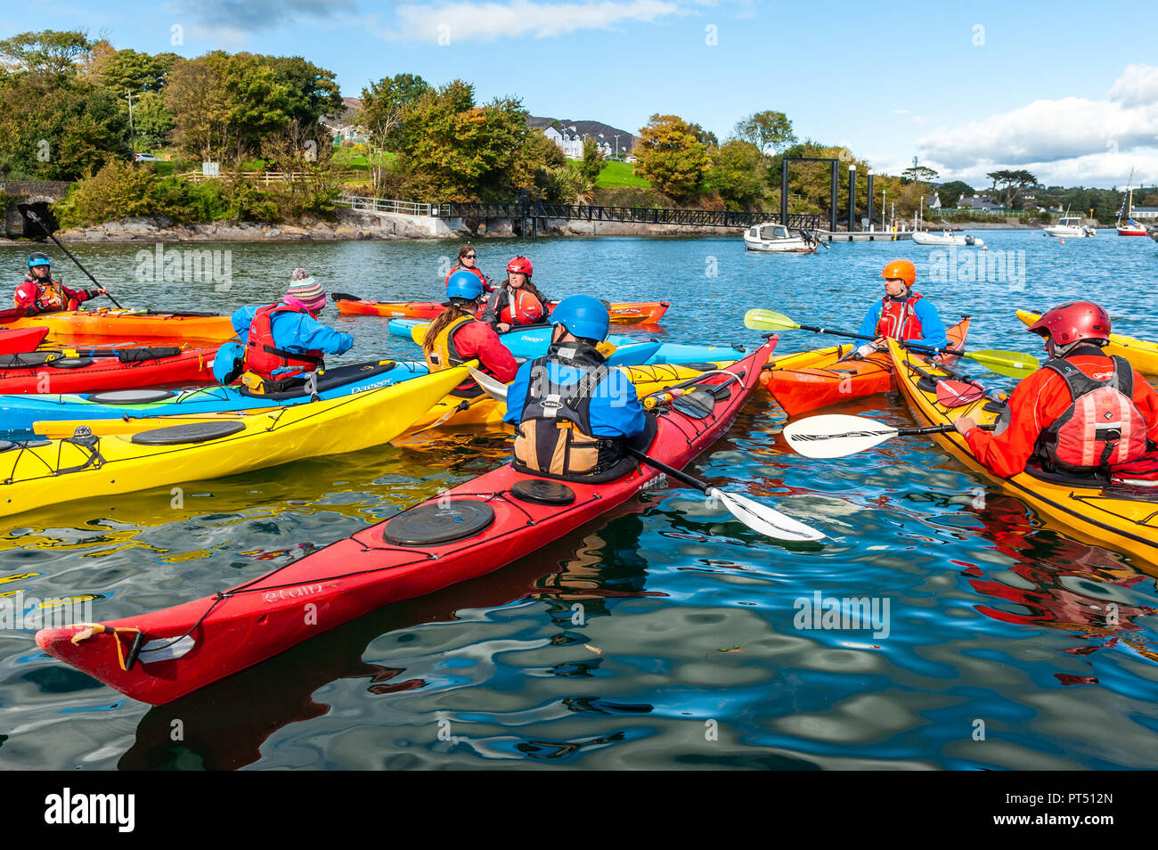 Schull, West Cork, Ireland. 6th Oct, 2018.  On a beautiful day in West Cork, kayakers prepares to go kayaking. Today's activities culminate this evening in a dinner dance at the Schull Harbour Hotel. Credit: Andy Gibson/Alamy Live News. - Stock Image