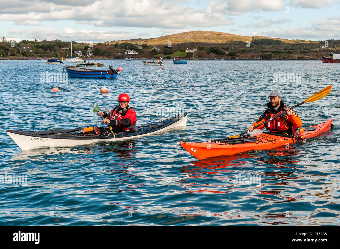 Schull, West Cork, Ireland. 6th Oct, 2018.  On a beautiful day in West Cork, kayakers prepare to go kayaking. Today's activities culminate this evening in a dinner dance at the Schull Harbour Hotel. Credit: Andy Gibson/Alamy Live News. - Stock Image