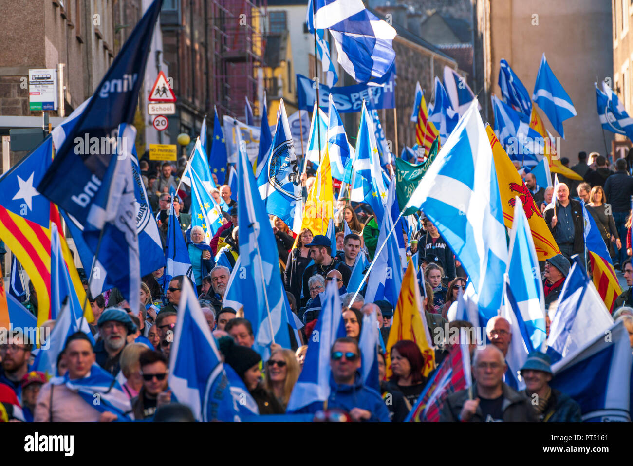 Edinburgh, Scotland, United Kingdom, 7th October 2018. All Under One Banner (AUOB) Scottish March and Rally for Independence. Pro- Scottish independence  supporters walking from Edinburgh Castle to the Scottish Parliament at Holyrood. AOUB is a pro-independence organisation. Credit: Iain Masterton/Alamy Live News - Stock Image