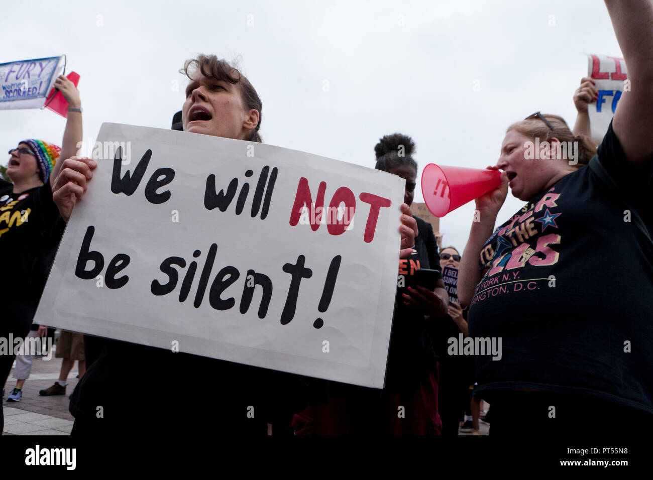 Washington, USA, 6th Oct, 2018: On the day of the final vote to confirm Brett Kavanaugh to the US Supreme Court, thousands of democrat activists protest in front of the Supreme Court building and the US Capitol. Pictured: woman holding sign which reads ' We Will Not Be Silent.'  Credit: B Christopher/Alamy Live News - Stock Image