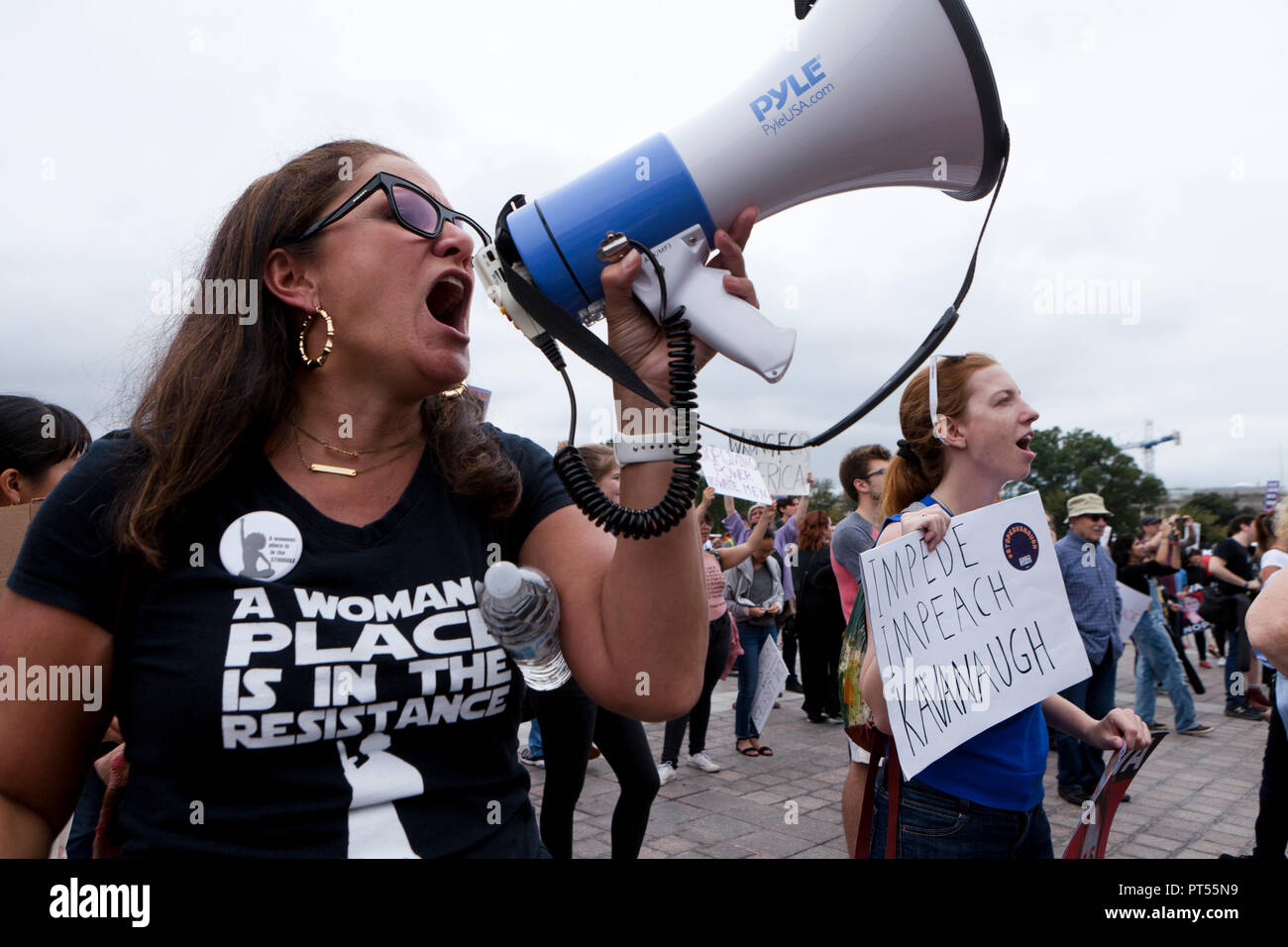 Washington, USA, 6th Oct, 2018: On the day of the final vote to confirm Brett Kavanaugh to the US Supreme Court, thousands of democrat activists protest in front of the Supreme Court building and the US Capitol. Pictured: Woman chanting into bullhorn against Justice Kavanaugh vote.  Credit: B Christopher/Alamy Live News - Stock Image
