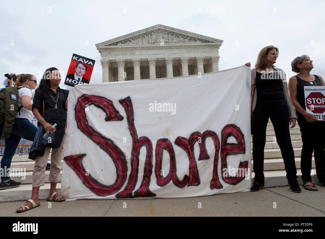 Washington, USA, 6th Oct, 2018: On the day of the final vote to confirm Brett Kavanaugh to the US Supreme Court, thousands of democrat activists protest in front of the Supreme Court building and the US Capitol. Pictured: Women holding 'Shame' banner in front of the US Supreme Court building.  Credit: B Christopher/Alamy Live News - Stock Image