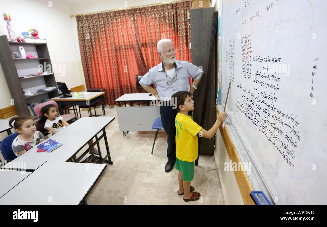 Nablus, West Bank, Palestinian Territory. 3rd Oct, 2018. Samaritan tutor Ragheb Mfarrej, 78, teaches kids the ancient Samaritan language, at Mount Gerizim near the West Bank city of Nablus, on October 3, 2018. The kids start learning Hebrew ancient language on their 6 years old, daily for a full round year. Today the ancient hebrew used by the samaritens in prayers, wedding, parties and circumcision. every samaritans males and females should learn this languge at 6 years, so he she can joine the real samaritan life Credit: Shadi Jarar'Ah/APA Images/ZUMA Wire/Alamy Live News - Stock Image