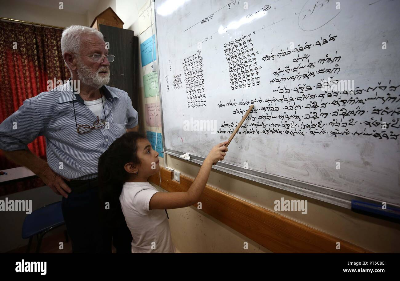 Nablus, West Bank, Palestinian Territory. 3rd Oct, 2018. Samaritan tutor Ragheb Mfarrej, 78, teaches kids the ancient Samaritan language, at Mount Gerizim near the West Bank city of Nablus, on October 3, 2018. The kids start learning Hebrew ancient language on their 6 years old, daily for a full round year. Today the ancient hebrew used by the samaritens in prayers, wedding, parties and circumcision. every samaritans males and females should learn this languge at 6 years, so he she can joine the real samaritan life Credit: Ayman Ameen/APA Images/ZUMA Wire/Alamy Live News - Stock Image