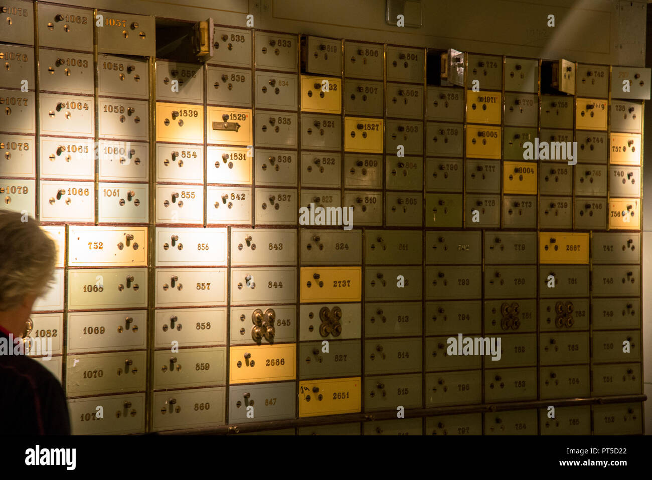 numbered old fashioned secure lockers at old bank building in Den Haag, Holland - Stock Image