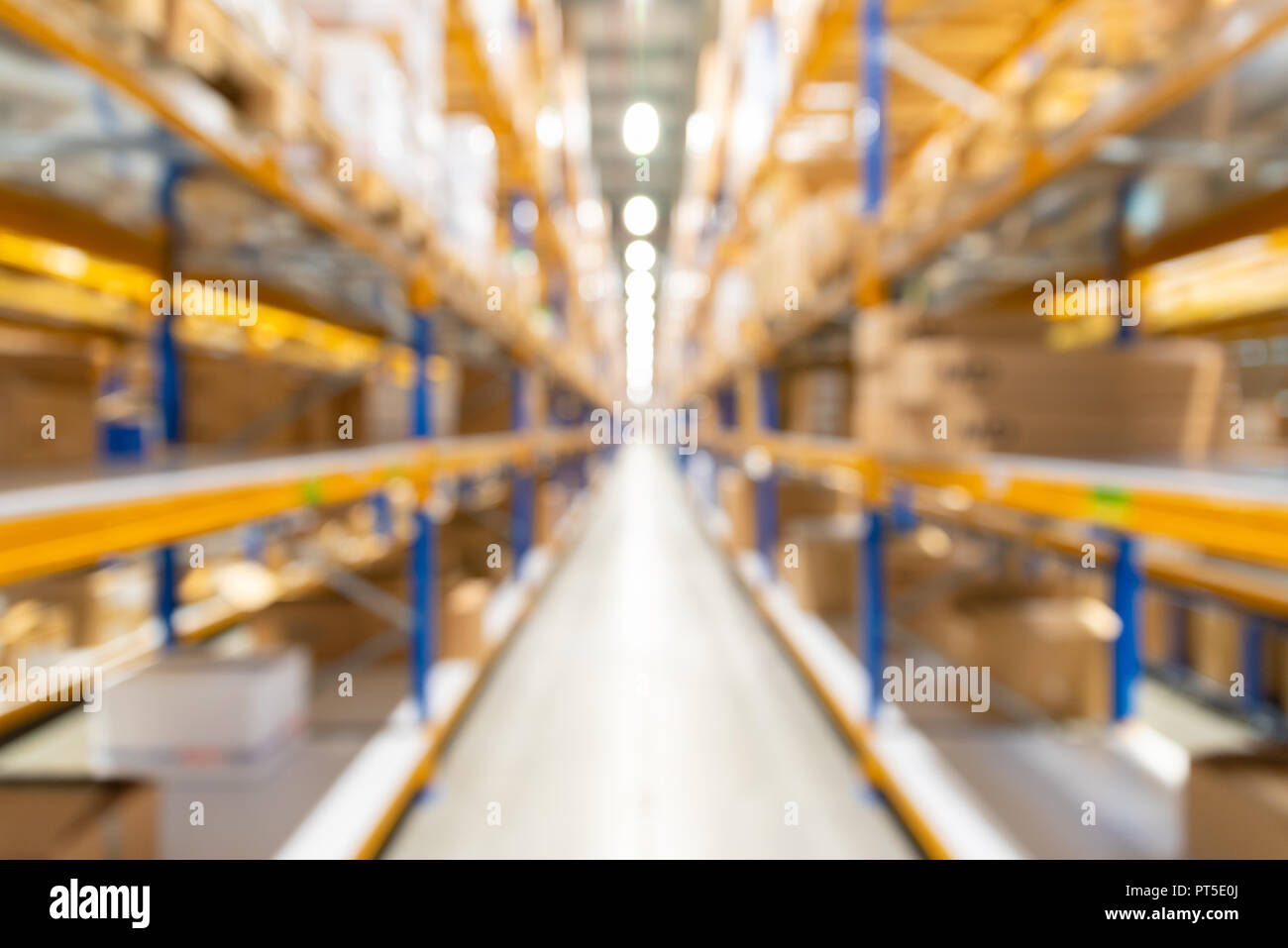 Abstract blurred warehouse at plant, background for industry Stock Photo